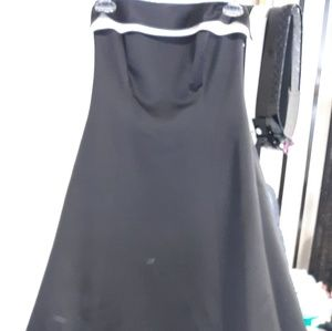 Black gown.   100%polyester.Dry clean only